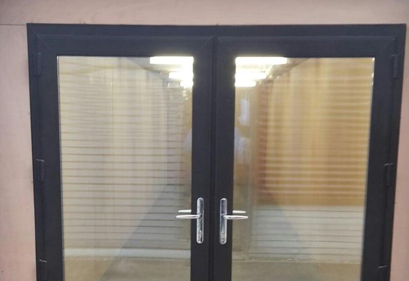 uPVC doors retro fitted behind original container doors 057