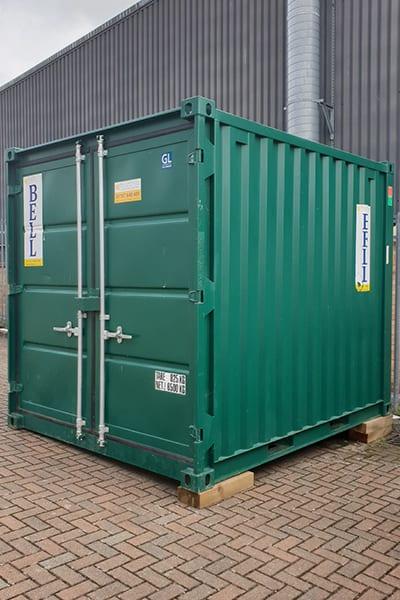 10ft storage container sitting on sleeper blocks