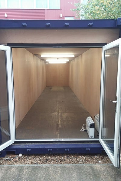 40ft container conversion with retro fitted uPVC doors behind original container doors