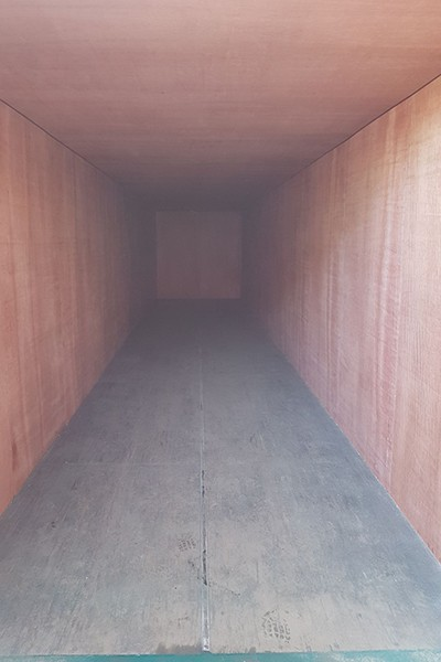 40ft container with internal walls and ceiling lined in ply boarding