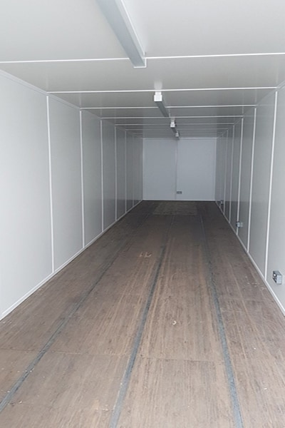 40ft container with internal walls and ceiling lined in white 15mm boarding