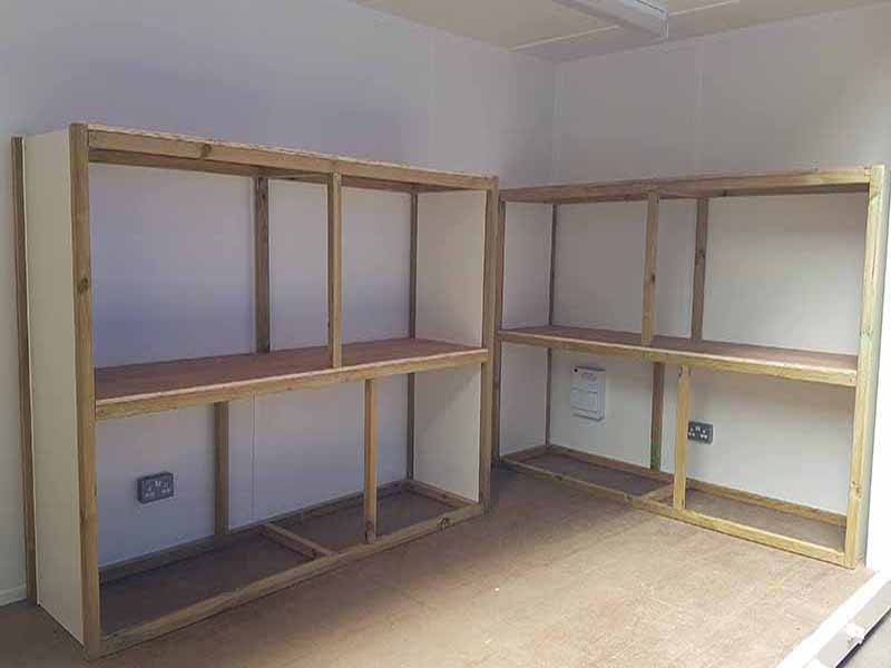 bespoke shelving system designed for container conversion
