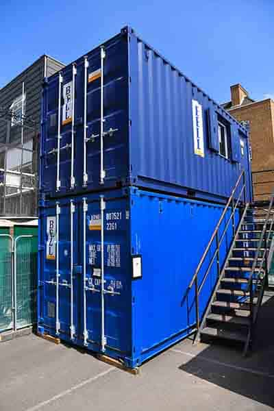 20ft steel storage containers in blue - stacked vertically