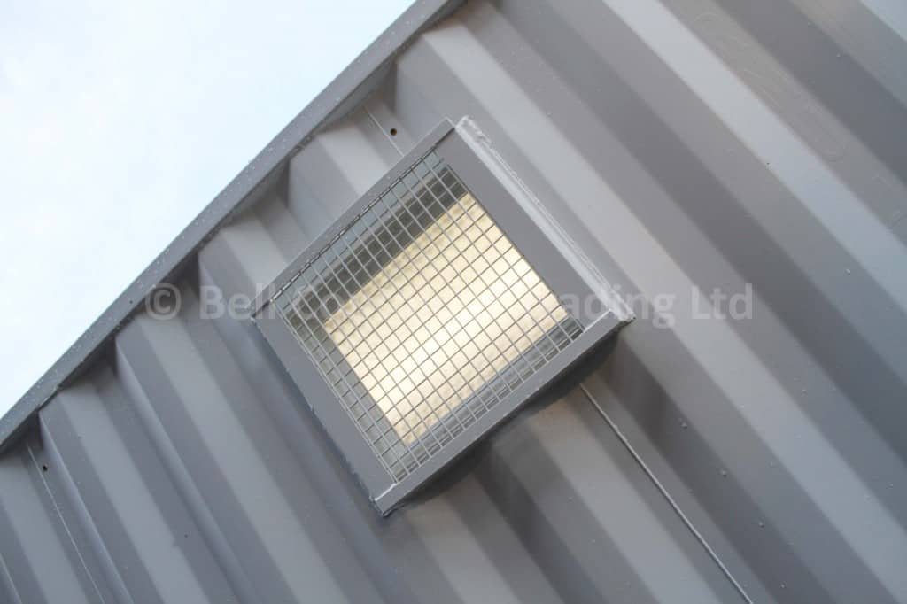 high level container windows with wire mesh