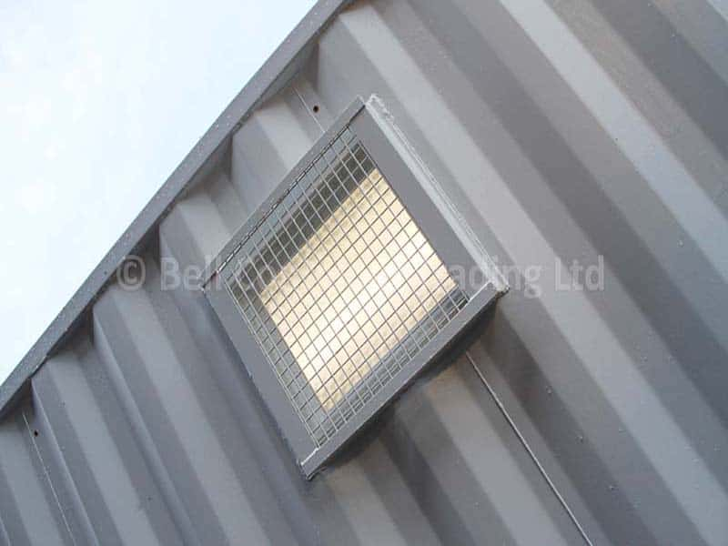 high level container windows with wire mesh guards