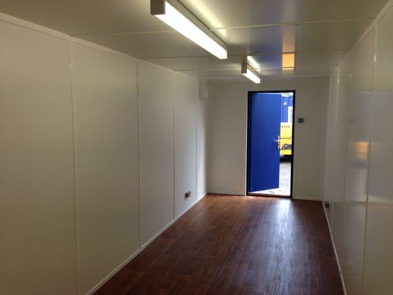 inside 40ft container with personnel door lining and electrics