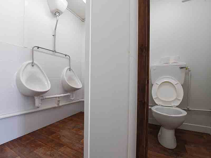 inside a 2+1 toilet block urinals and WC