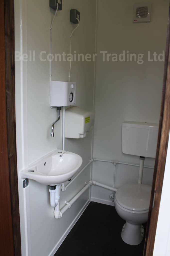 inside converted shipping container shower and toilet WC cubicle