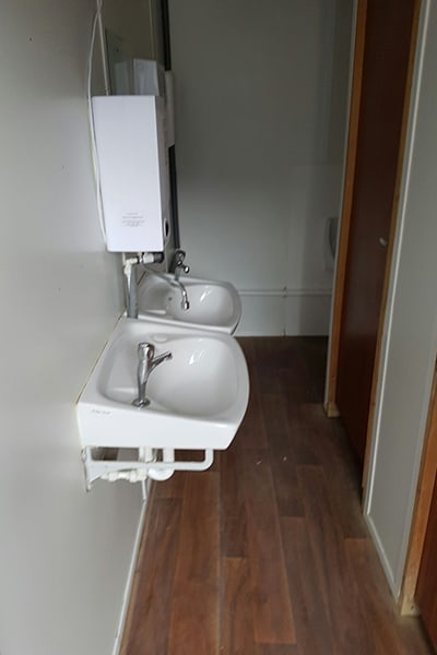 sink unit and hot water boiler from inside 2+1 toilet block