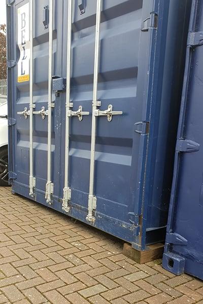 storage container sitting on sleeper blocks