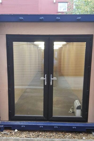 uPVC doors retro fitted behind original container doors 1